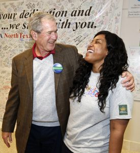 President George W. Bush hugs nurse and Ebola survivor Amber Vinson at Texas Health Presbyterian Hospital Dallas on Nov. 7, 2014. Image/Texas Health
