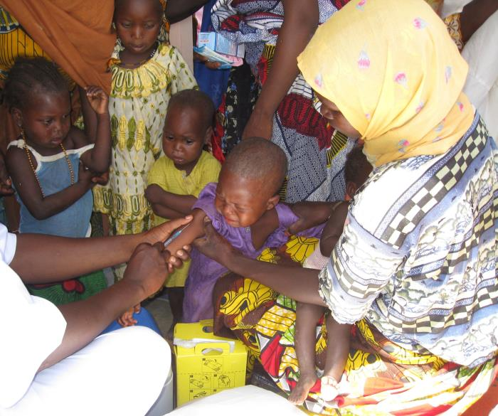 Nigerian child receiving vaccination/Stacey Hoffman, M.P.H., NCIRD