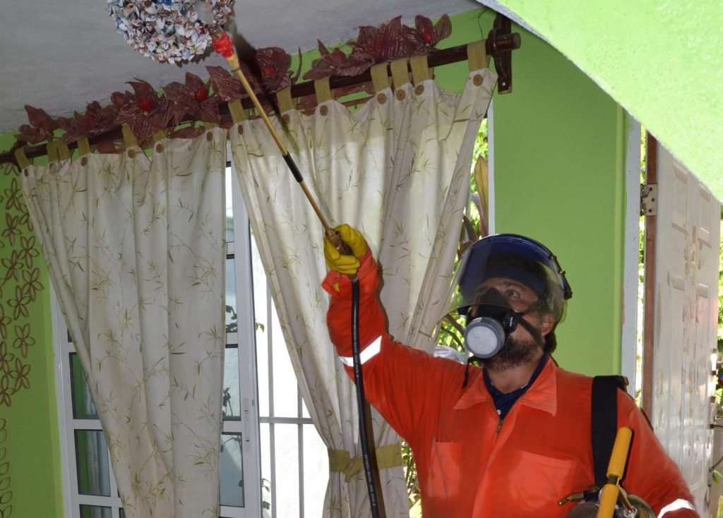 A research technician sprays the ceiling and walls of a home in Merida, Mexico, as part of the first study to show how vital insecticide-resistance monitoring is to control a mosquito that can spread the Zika virus. Image/Nsa Dada