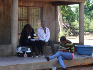 Health care workers visit households in Southern Mozambique to identify men infected with the malaria parasite but presenting no symptoms. Image/Beatriz Galatas