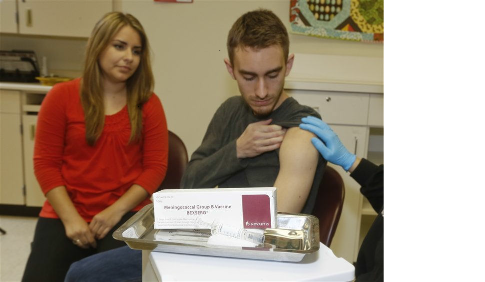 Meningococcal meningitis survivor and vaccination advocate Leslie Meigs looks on as her brother Andrew (18), a college student in Texas, receives Bexsero®, a meningococcal group B vaccine approved by the FDA for ages 10-25 in January. Meningococcal group B is one of the most prevalent types of meningococcal disease in the US, and adolescents and young adults are at risk due to common lifestyle habits such as living in college dormitories. Bexsero is approved to help protect against the potentially deadly disease in two doses, however is not expected to cover all group B strains.