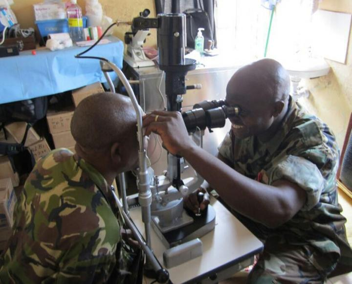 Ophthalmology Nurse Fayiah Momorie trains with a new slit lamp in Military Hospital 34, Freetown, Sierra Leone. Image/University of Liverpool