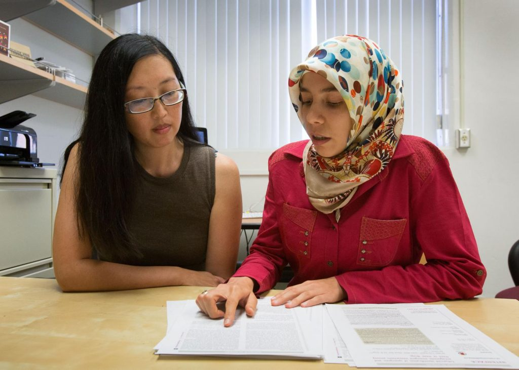 """""""We shouldn't limit ourselves to just single drugs or two-drug combinations in our medical toolbox,"""" said Pamela Yeh (left), with Elif Tekin. Image/Reed Hutchinson/UCLA"""